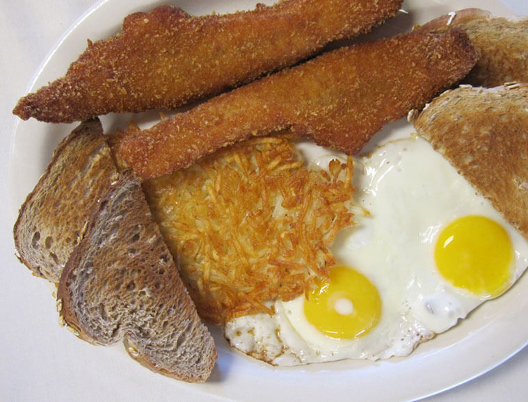 Plate of deep fried walleye, toast, hashbrowns and eggs